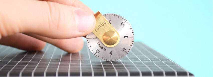 the compact 'rollbe' measuring tool is no larger than a coin