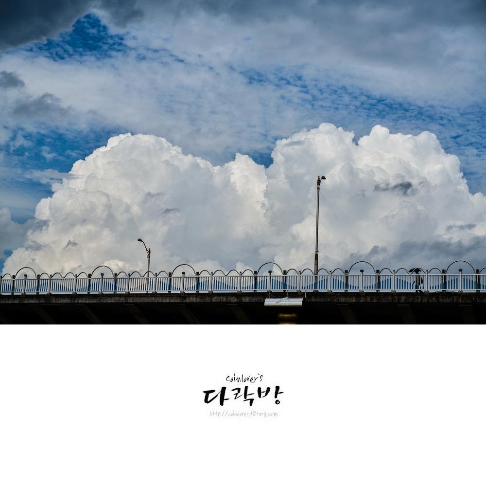 구름의 대지 - 아다치 미츠루 구름 아래의 진주